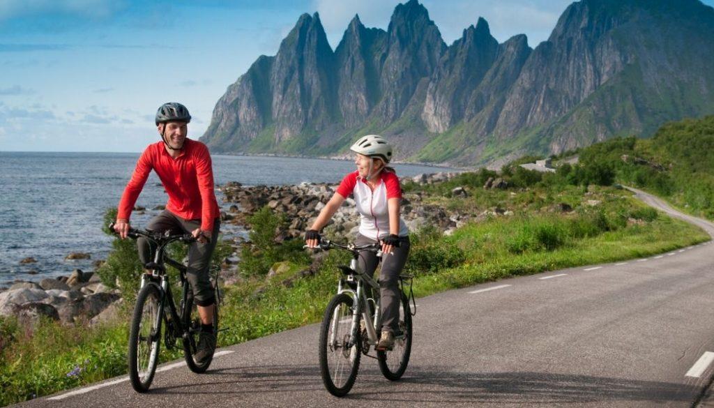 couple wearing road bike helmets under 100