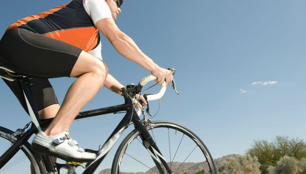 man biking in bib shorts for endurance cycling