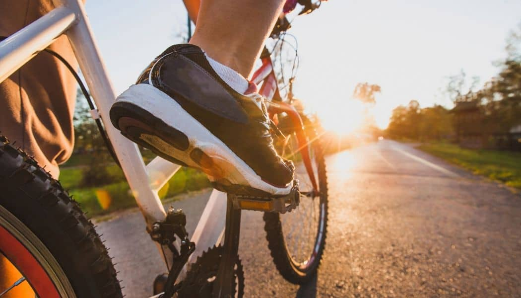 regular non cycling shoes with bike and sunlight background