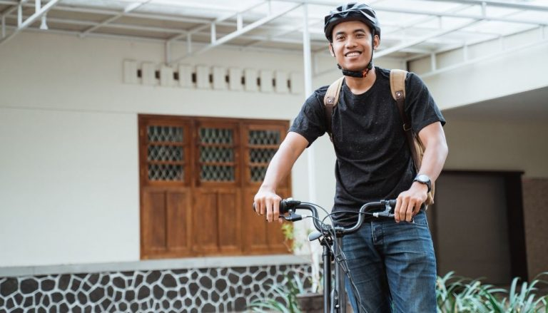 college male student riding a bike