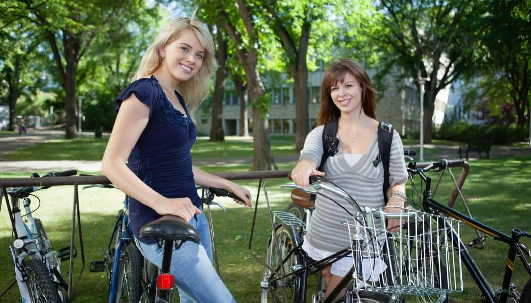 college students with bicycles