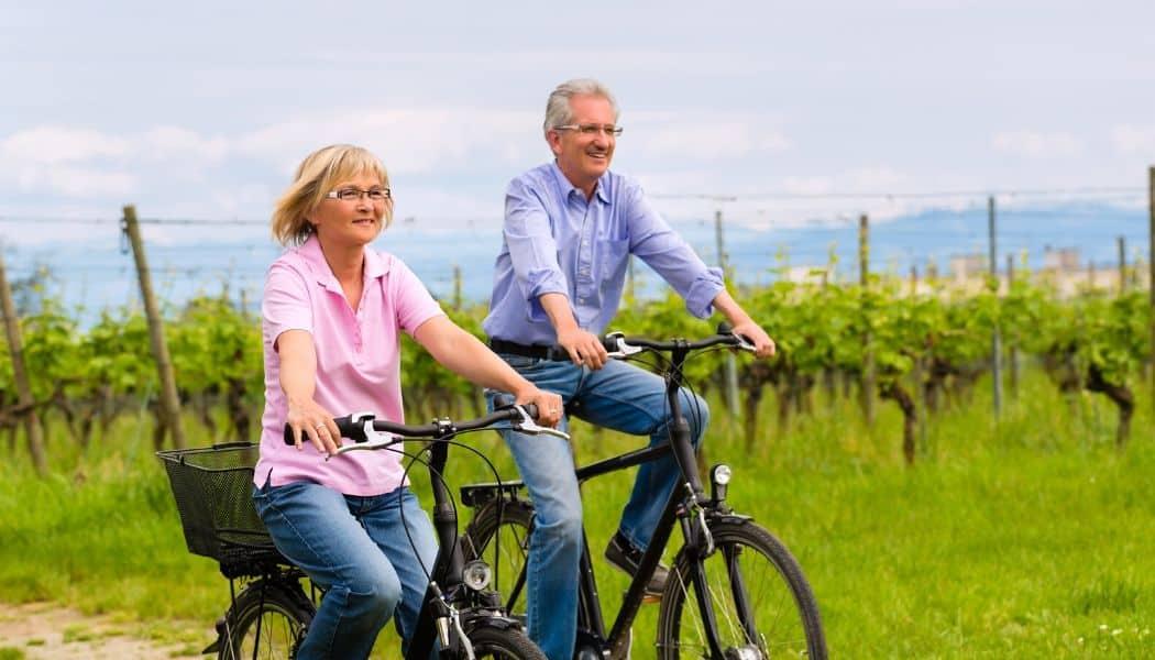couple riding bikes for seniors