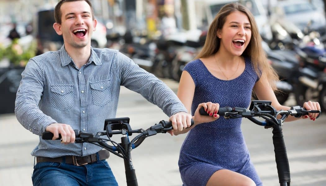 couple riding folding electric bikes