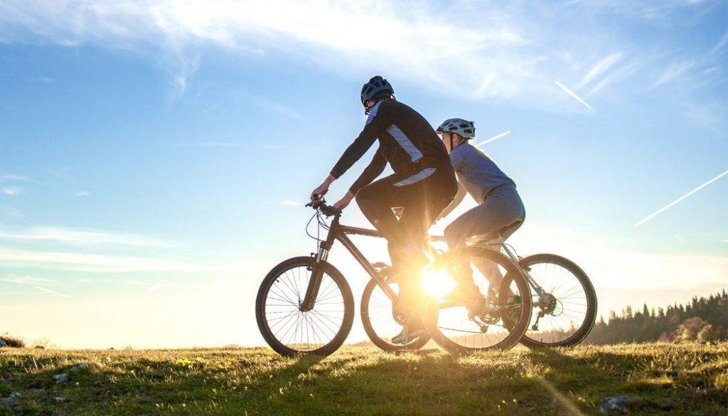 couple riding full suspension mountain bikes under 2000