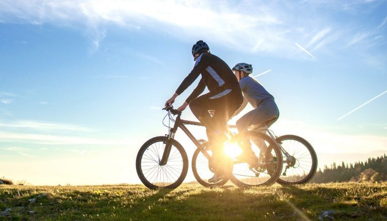 couple riding full suspension mountain bikes under 2000