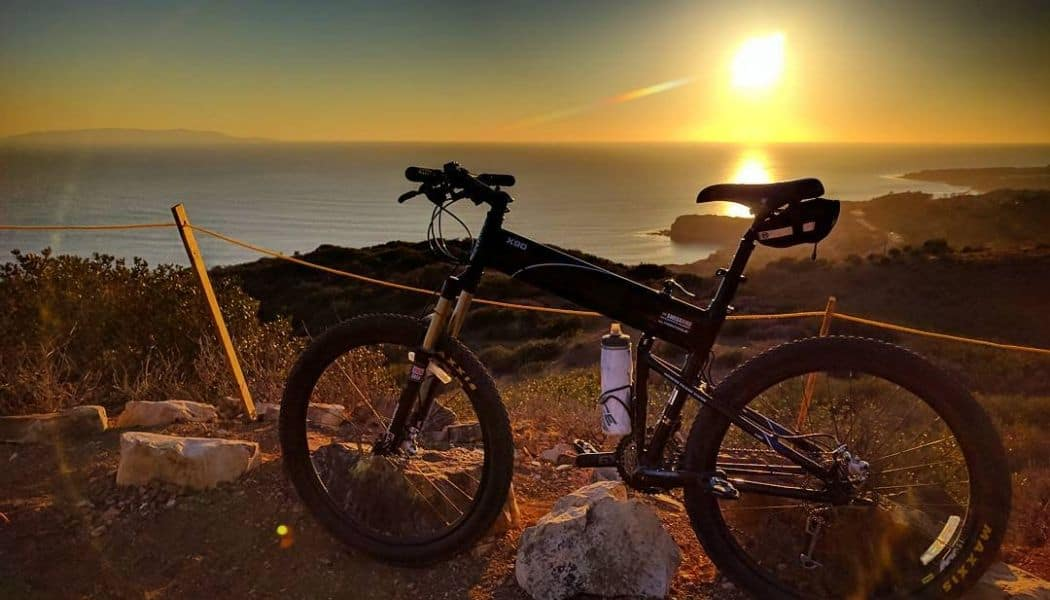 folding mountain bike with sea background