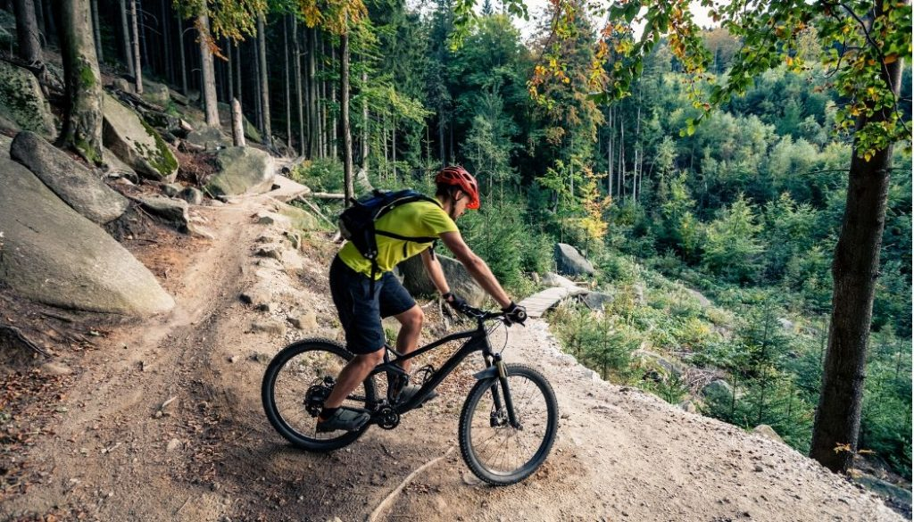 man riding a beginner mountain bike