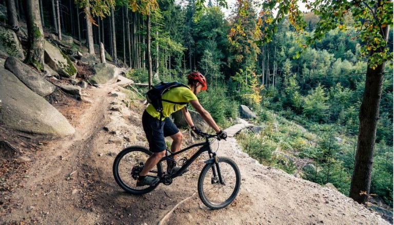 man riding a beginner mountain bike