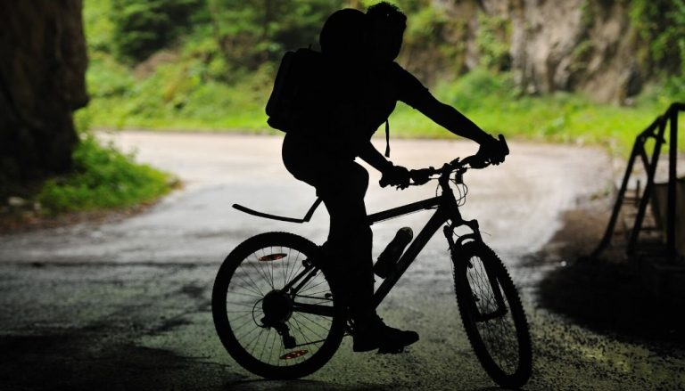 man riding a folding mountain bike