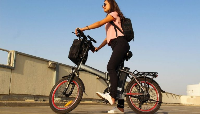 young woman riding electric bicycle under 1000