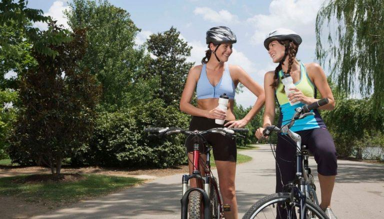 women riding hybrid bikes under 1000